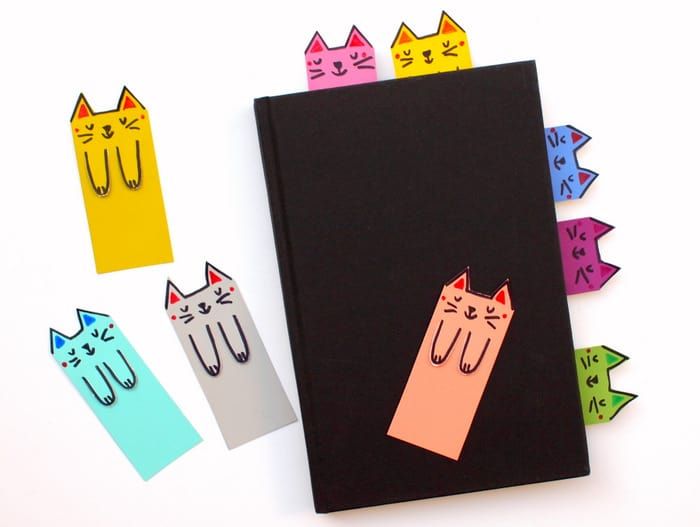 Instead of using random scraps of paper, I whipped up these super colorful and cute kitty themed DIY bookmarks out of paint chips!