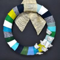 This felt DIY wreath is so versatile . . . choose any colors of felt that you'd like, and any embellishments that your heart desires!