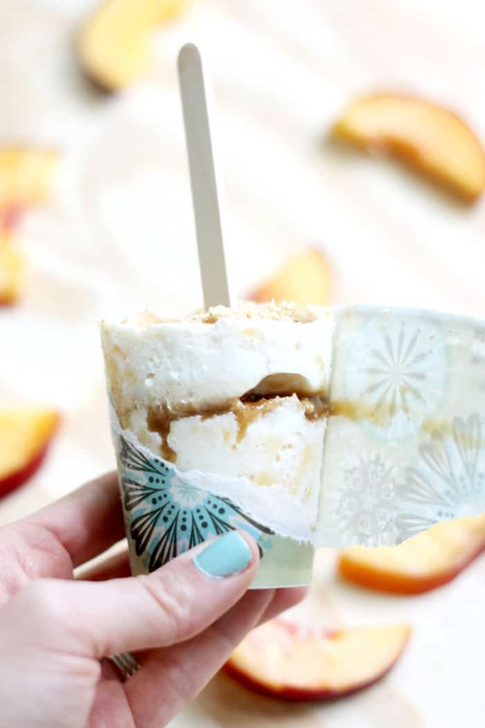 This popsicle recipe combines all the best parts of peach pie and ice cream with the deliciousness of rich honey caramel sauce. A perfect sweet treat!