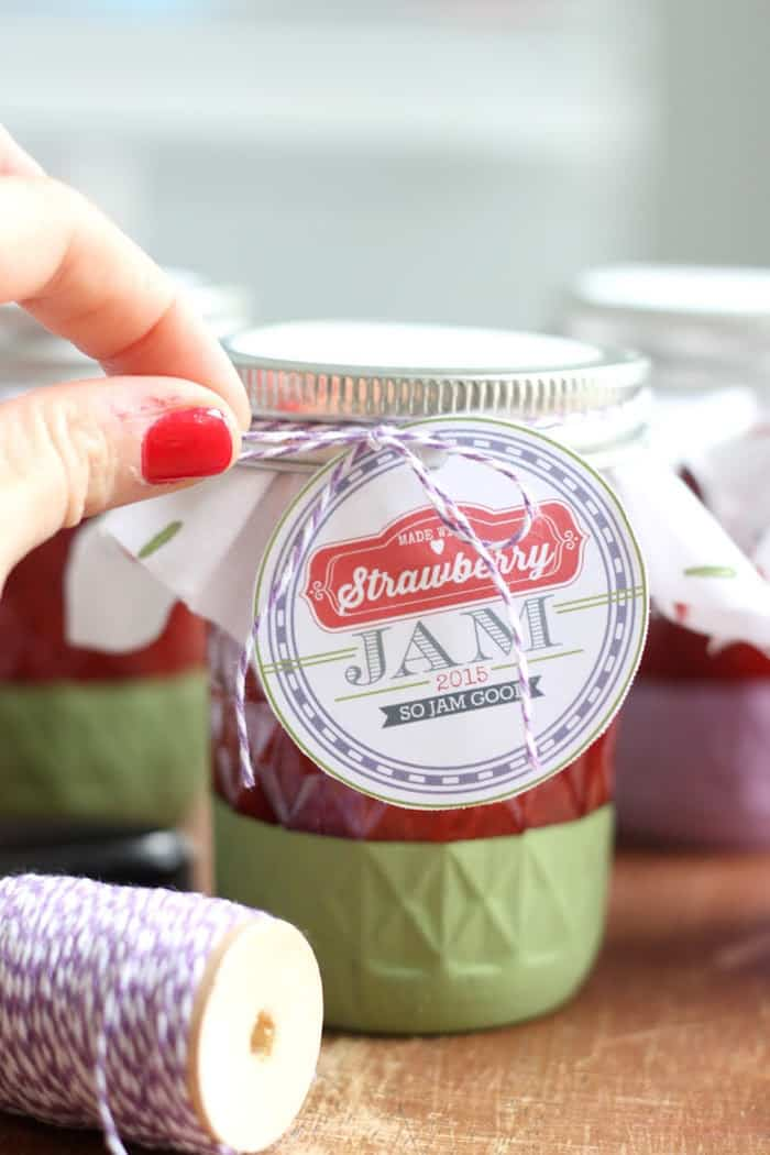 Tying baker's twine onto a mason jar