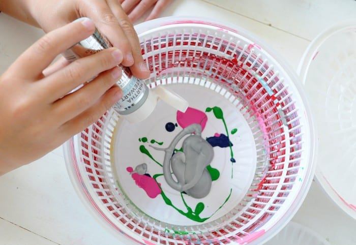 Spin art machine from a salad spinner - adding paint