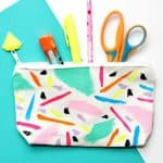 You don't need painting skills to create these beautiful abstract zipper pouches - with a custom DIY gem charm that you can make!