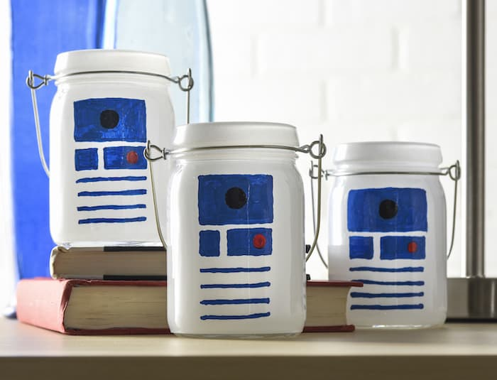 This Star Wars craft is SO easy to make! I used dollar votives and paint pens to celebrate my love of R2D2 and create some cool luminaries.