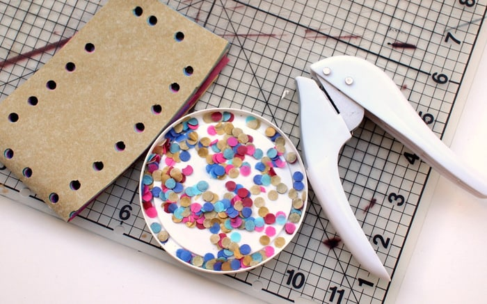 Making confetti with tissue paper and a hole punch