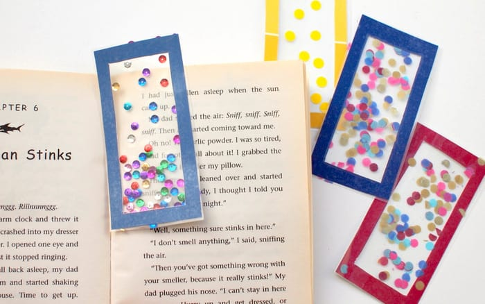 Make your own bookmark with paint chips, clear contact paper, and confetti