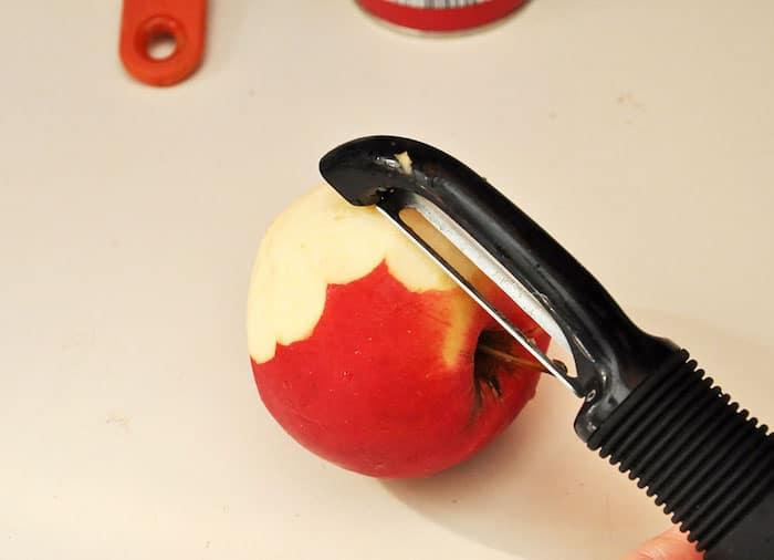 Peeling an apple with an apple peeler