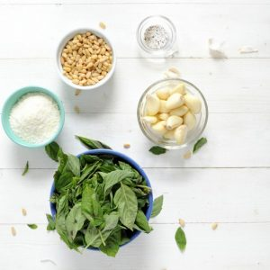 Classic Pesto Recipe Ingredients - pine nuts, garlic cloves, parmesan, basil