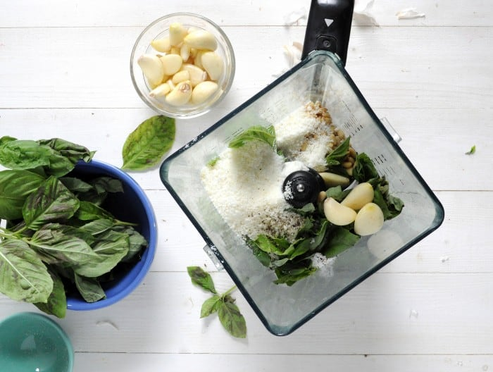 Homemade pesto recipe - ingredients combined in a blender