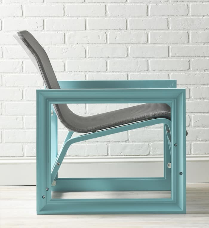 This amazing IKEA hack is a chair constructed with two large wood photo frames! Learn how to make this unique piece of furniture.