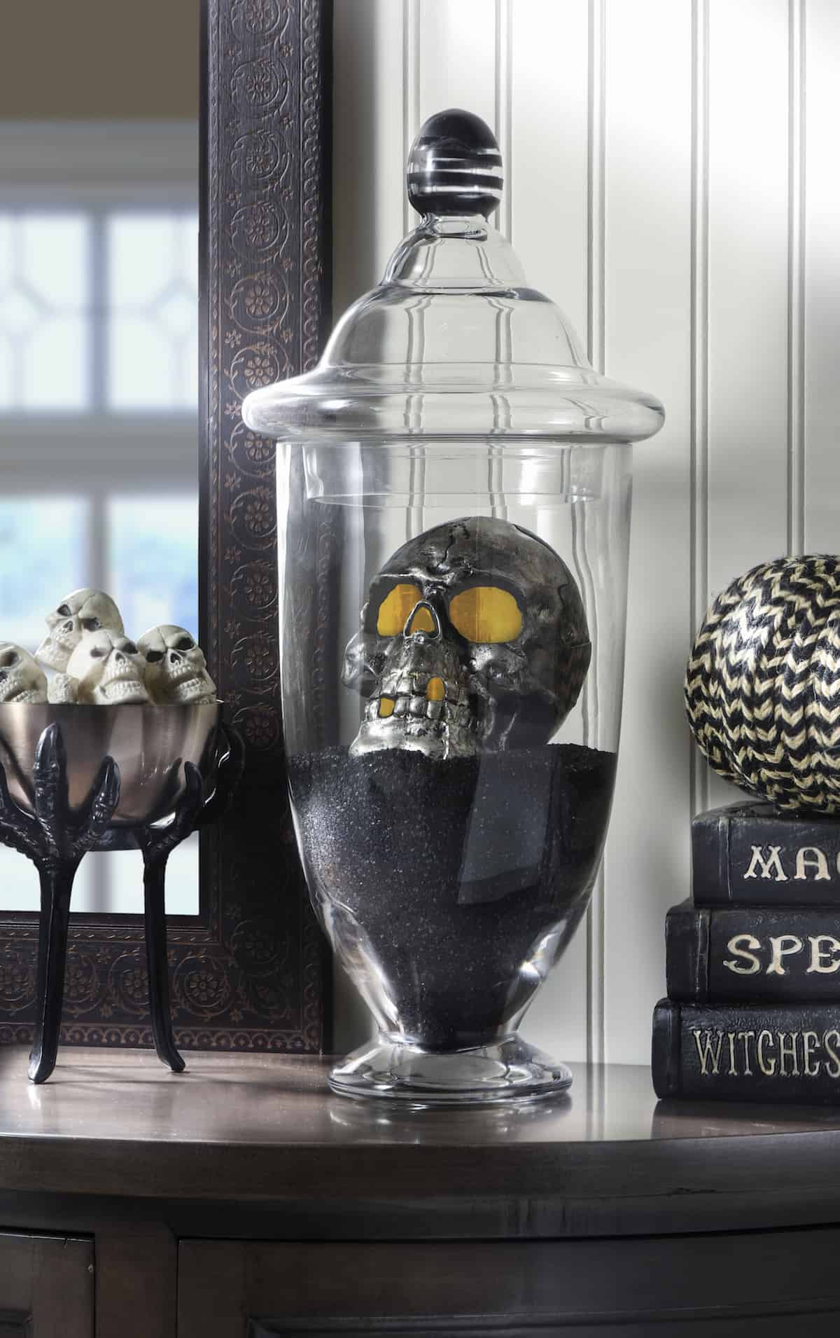 This DIY Halloween skull display takes only a few minutes to put together - it's the perfect last-minute holiday decor idea!