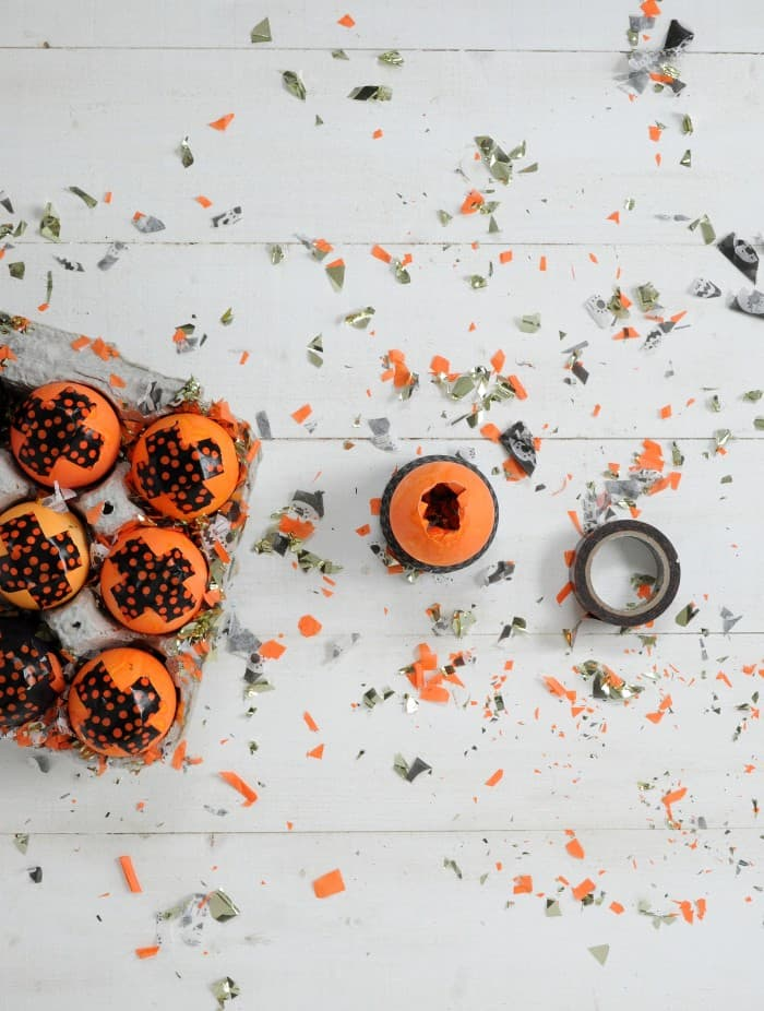 Cascarones are an Easter tradition of confetti-filled fun - adapt them to Halloween with this cute orange and black version. Kids will love these!