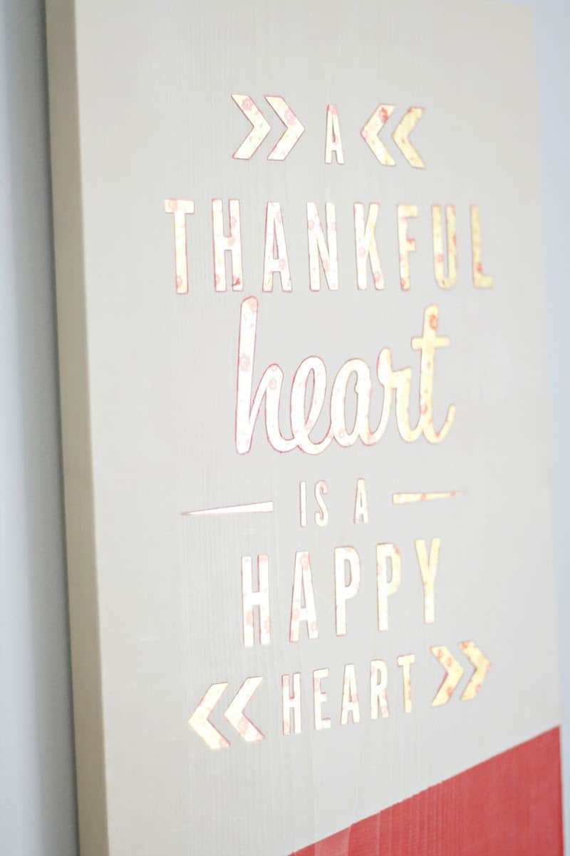Use this simple tutorial to make Thanksgiving wood wall art that you can keep up all year! This sign is easy to create with leftover wood and stickers.