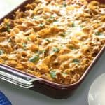 This delicious enchilada casserole makes a perfect meal for a family. It's tasty with a bit of Mexican flair - and the calorie count is just right!