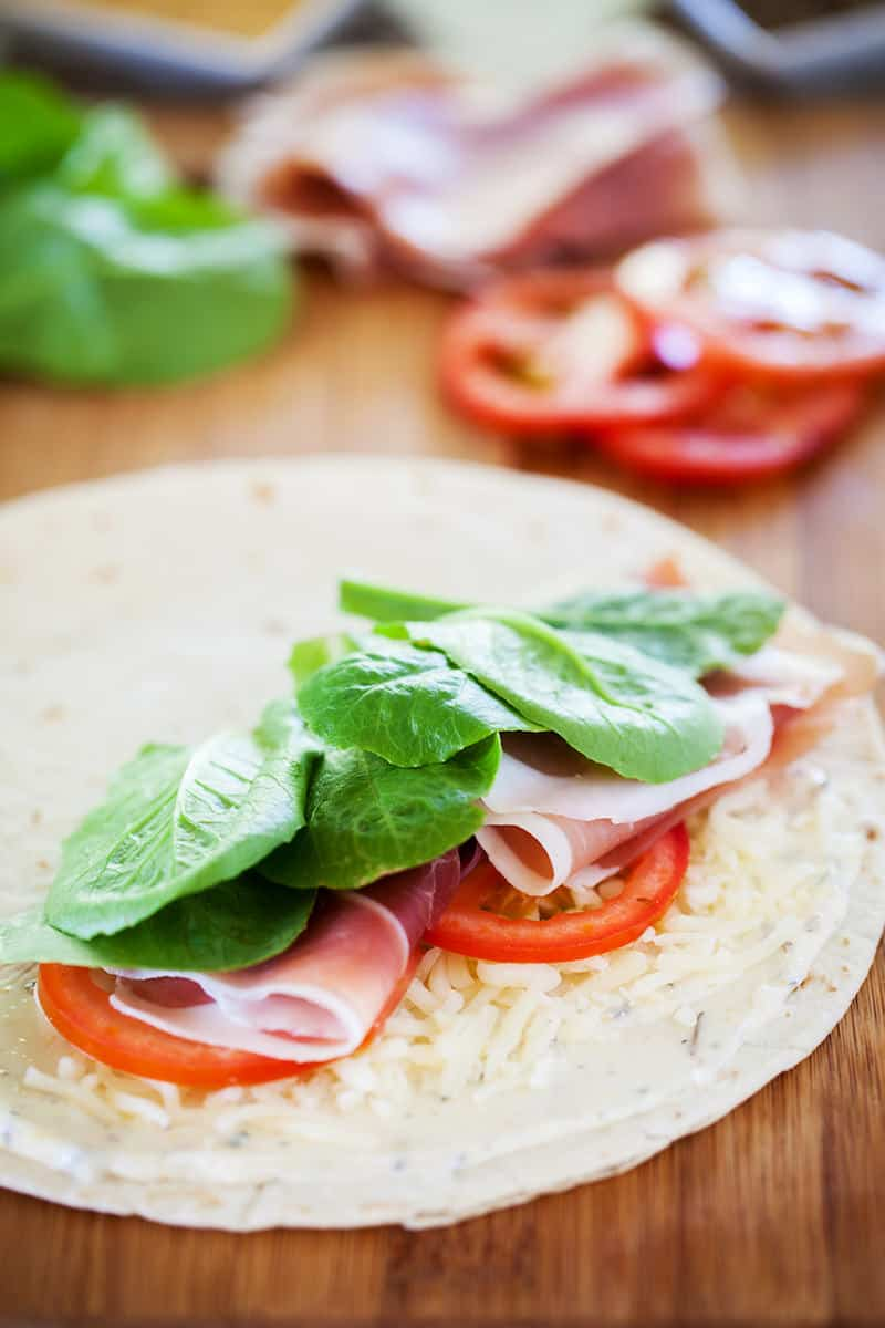 This quesadilla recipe is packed with flavor. Savory prosciutto, juicy tomatoes, crunchy kale and cheesy mozzarella on top of garlic butter - delicious!