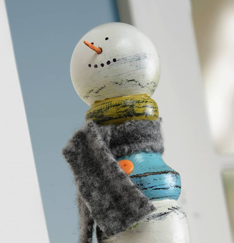 Grab a wood spindle from the hardware store or a construction site and turn it into this unique snowman craft. It's the perfect seasonal display piece!