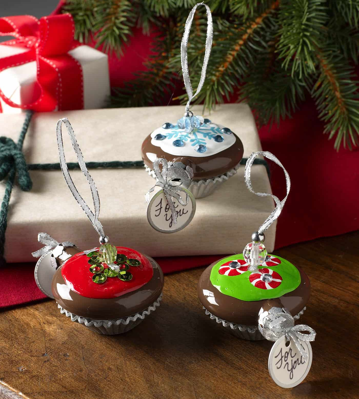 These handmade Christmas ornaments are regular ornaments painted to look just like cupcakes! Have you ever seen anything so sweet?