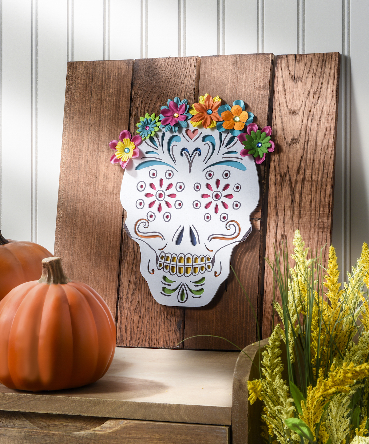 This unique calavera (skull) art was made using a recycled pallet. Perfect for Dia de Los Muertos, but you can keep it up all year!