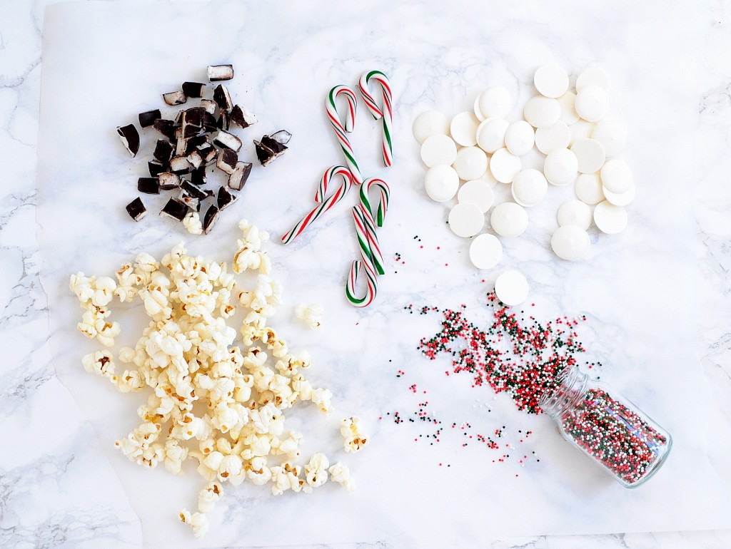 This delicious popcorn recipe is perfectly festive for Christmas with peppermint patties, candy canes, and red/green sprinkles! Your family will love it!