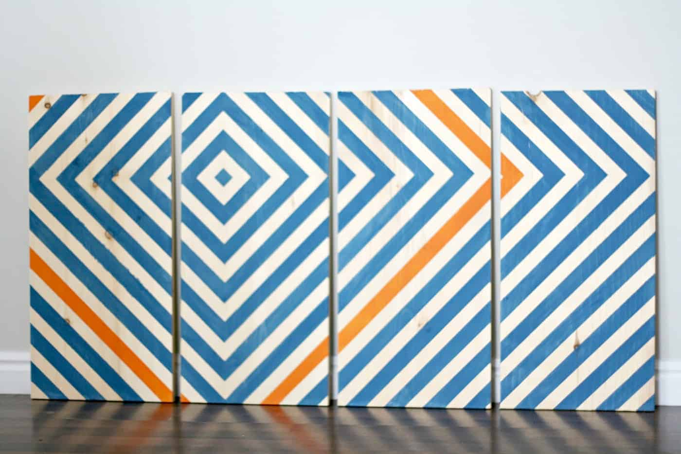 Add a pop of color to your home with this simple modern, wooden wall art. Learn how to make it with scrapbook using this tutorial.