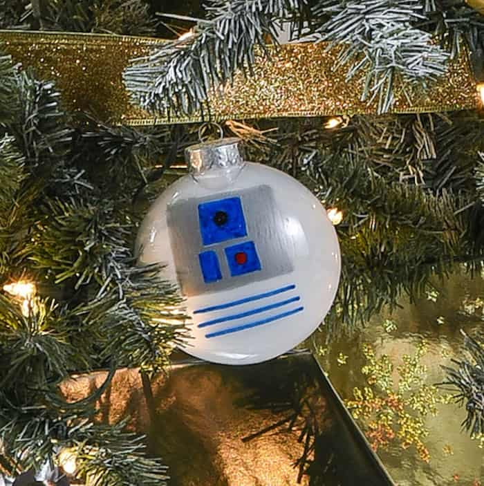 Rebels will love this droid themed Star Wars Christmas tree! Learn how to easily make your own C-3PO and R2-D2 ornaments.
