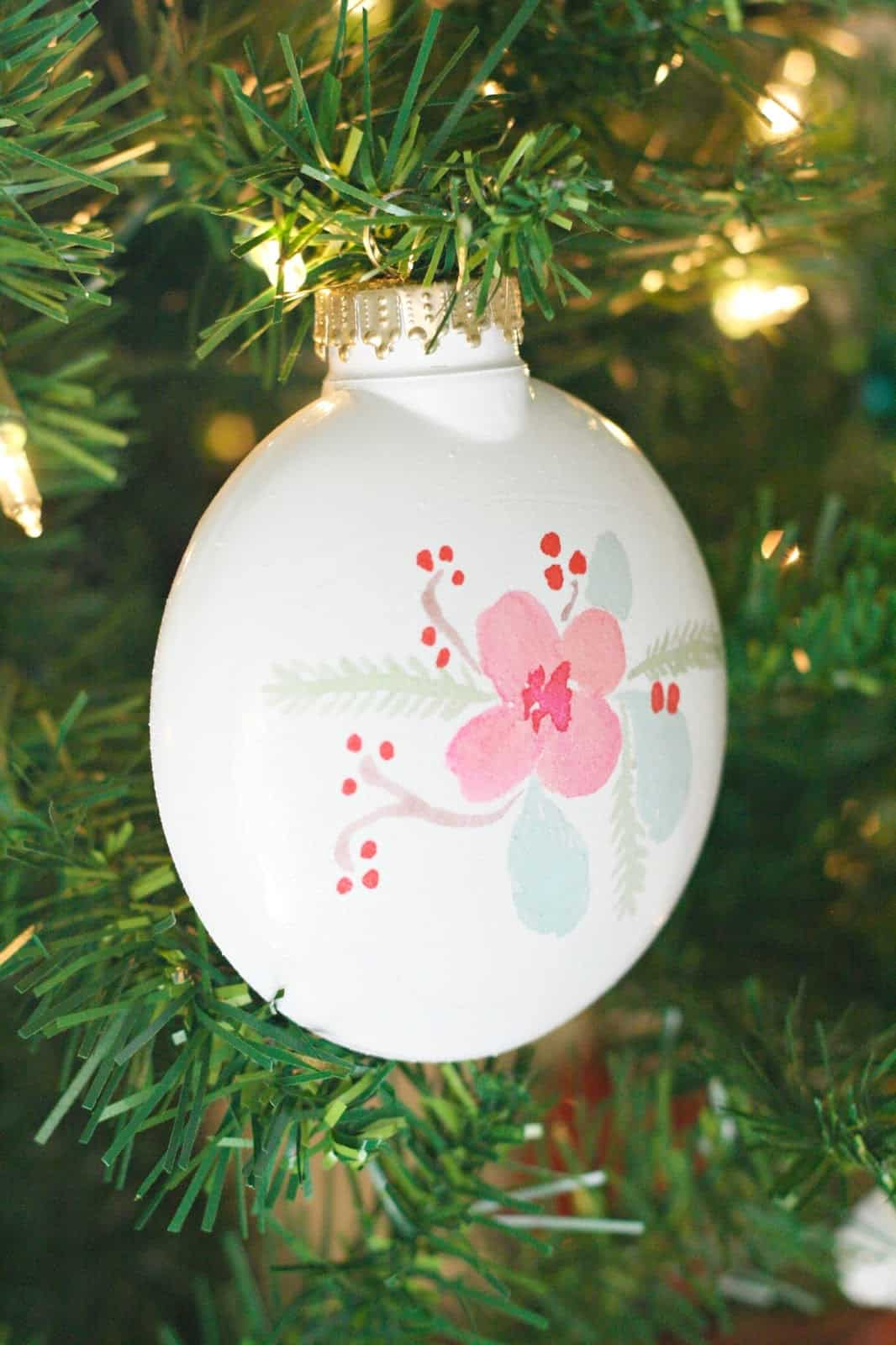 These DIY Christmas ornaments are made using temporary tattoos! They are one of my favorite holiday projects ever and the possibilities are endless.