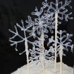 Make hot glue snowflakes and use them as a fabulous DIY cake topper! This craft is perfect for winter, Christmas, or New Year's Eve.