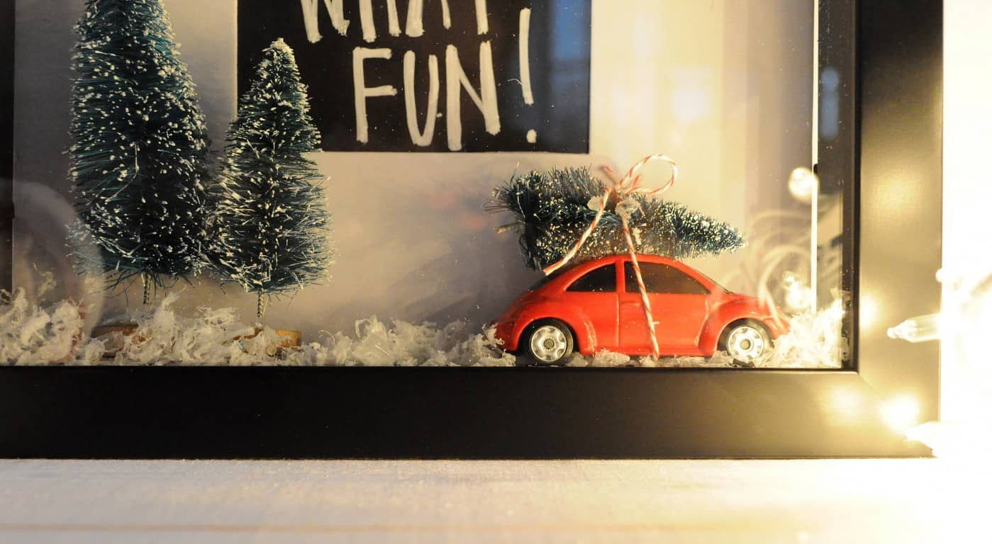 This DIY Christmas shadow box is a fun take on the festive snow globe trend! It incorporates one of the season's most popular trends: trees on cars.