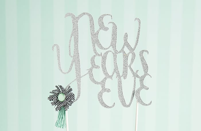"Jazz up your New Years Eve with an easy-to-cut cake topper. Pair it with some glitzy glitter paper, and you have serious ""wow-factor"" for your celebration!"