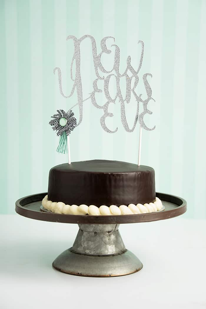 """Jazz up your New Years Eve with an easy-to-cut cake topper. Pair it with some glitzy glitter paper, and you have serious """"wow-factor"""" for your celebration!"""