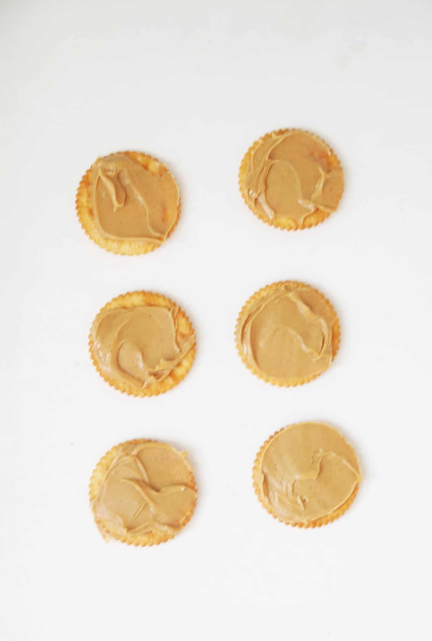 Peanut butter on top of crackers