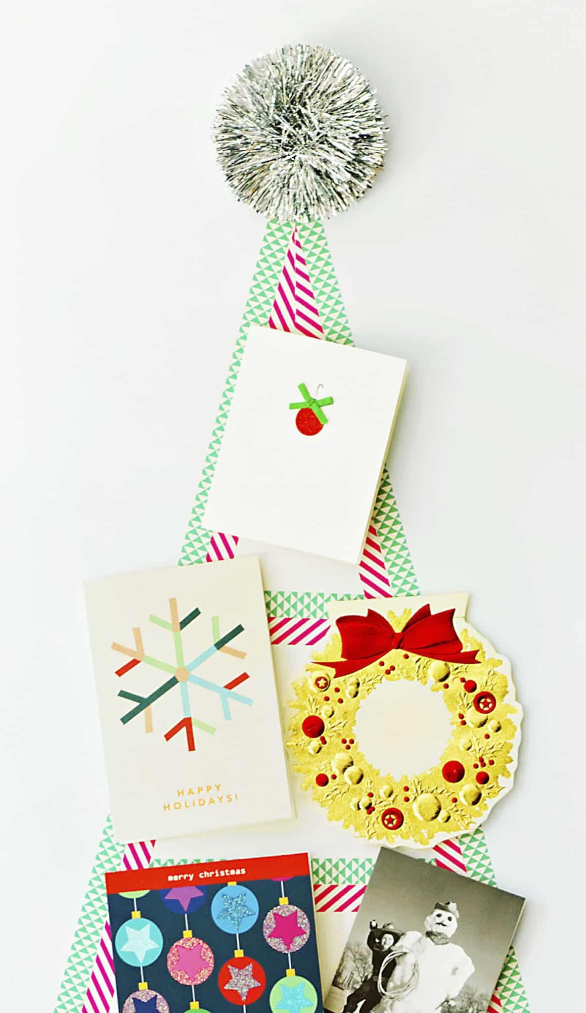 This DIY washi tape tree is a no-fuss way to display the holiday cards that arrive in your mailbox each day! It comes right off the wall when you're done.