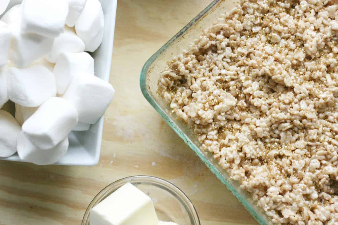 Marshmallows, butter, and rice krispies pressed into a glass pan