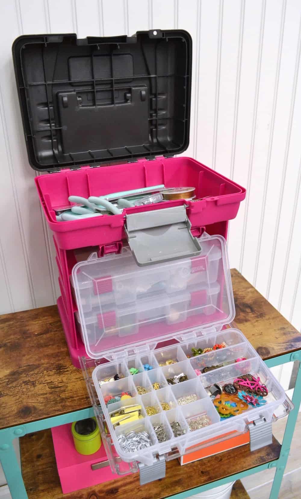 Large jewelry organizer with plastic containers and compartments