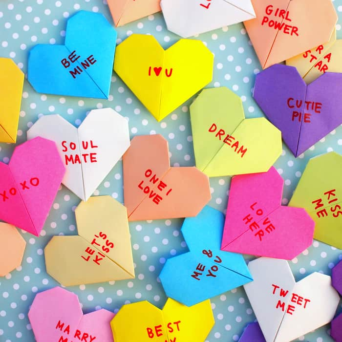 Here's an easy way to fold and decorate origami bookmarks to look just like those adorable and iconic Valentine's Day conversation heart candies!