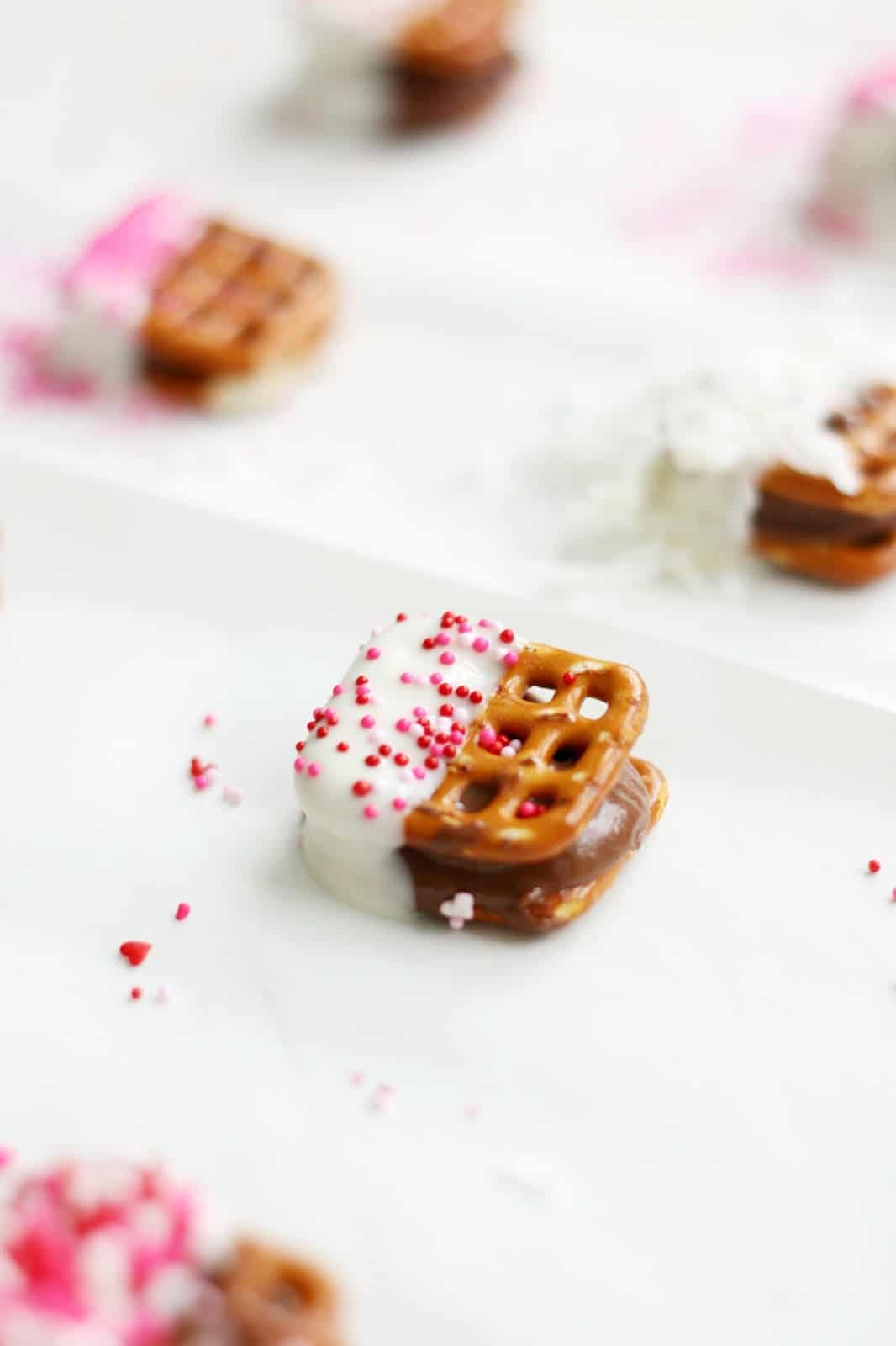 Rolo pretzel turtles are easy to make! These have a Valentines twist, dipped in white chocolate with pretty pink and white sprinkle touches.