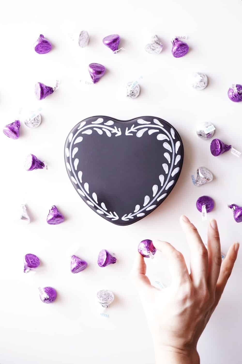 Instead of spending a lot on a paper box of chocolates, repurpose any tin and decorate it to give your valentine their own stash of sweets.