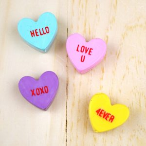 To profess my love for conversation hearts, I made some colorful little magnets to stick on the file cabinet for Valentine's Day! What a great gift idea.