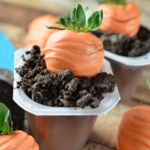Dirt pudding cups for Easter with strawberry carrots