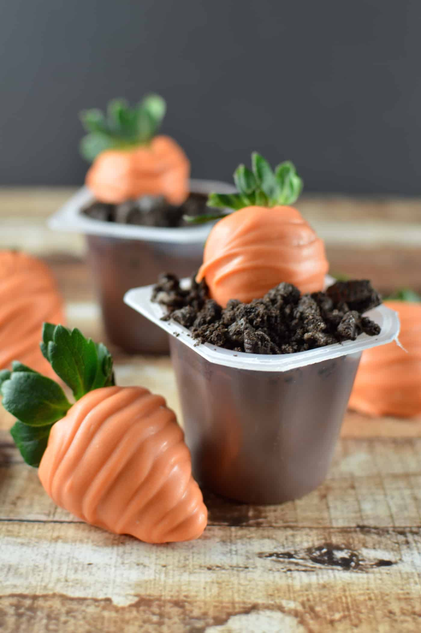 "Make these darling Easter treats with pudding cups, Oreos, and strawberries. These are the cutest carrots in delicious cookie ""dirt!"""