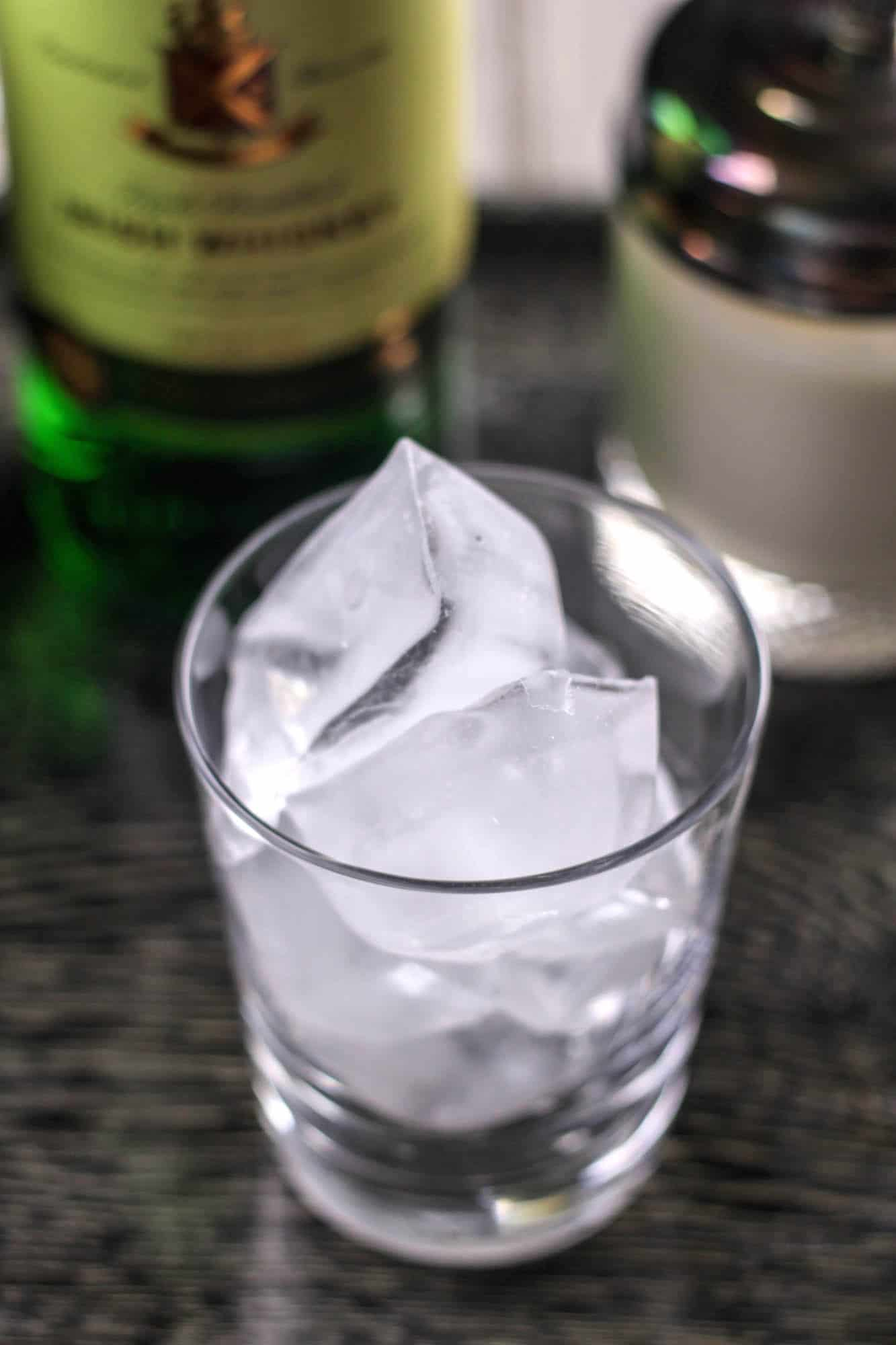 Empty whiskey glass with ice cubes