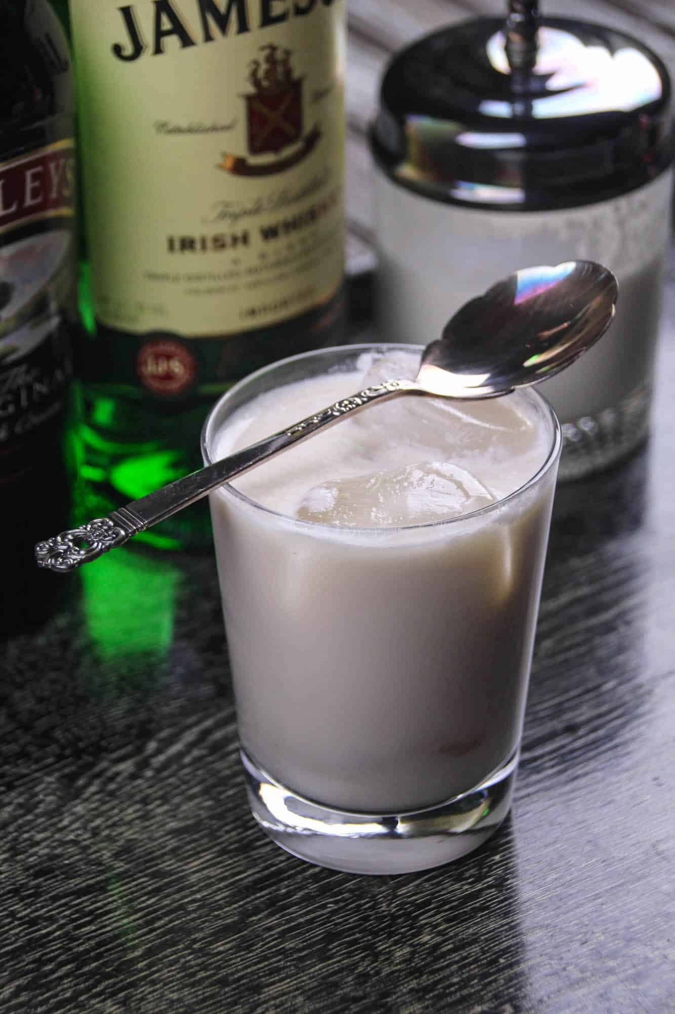 Irish White Russian cocktail with a spoon set on top of the glass