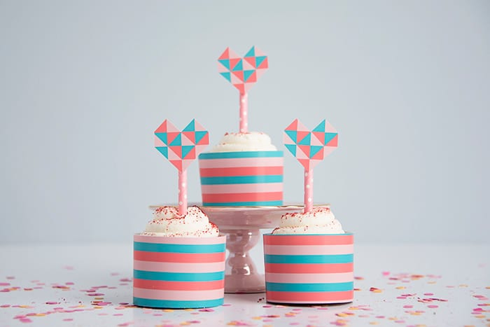These cute geometric heart cupcake toppers are perfect for Valentine's Day or a girl's themed birthday party. Grab the free printable here!