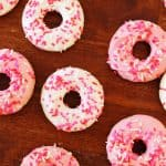 This delicious donuts recipe uses candy melts instead of frosting for the ultimate sweetness. Add Valentine's Day sprinkles or customize for any holiday!