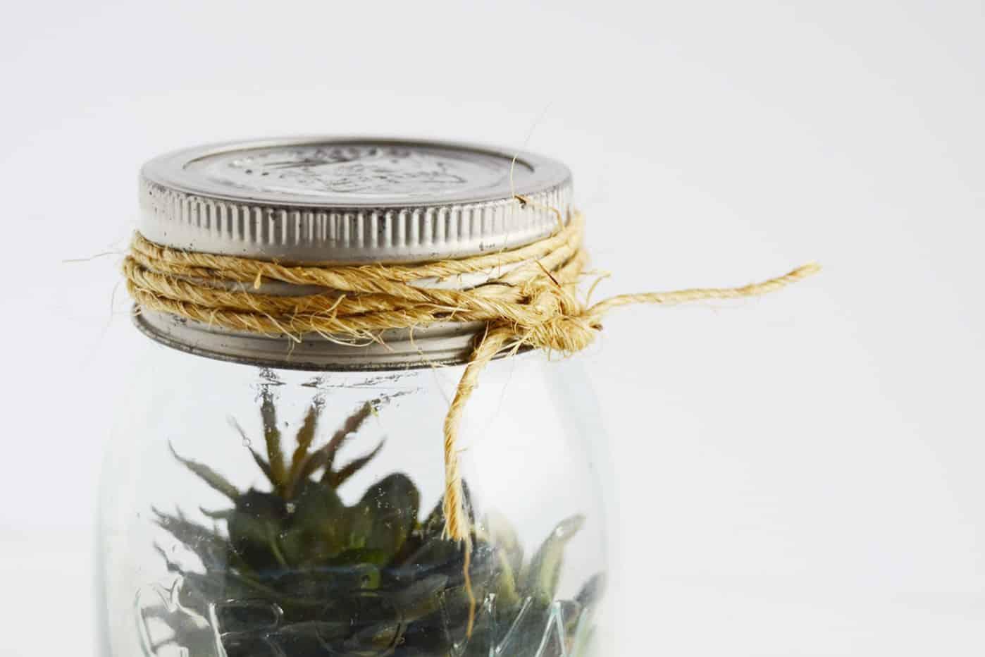 Twine tied around a mason jar lid