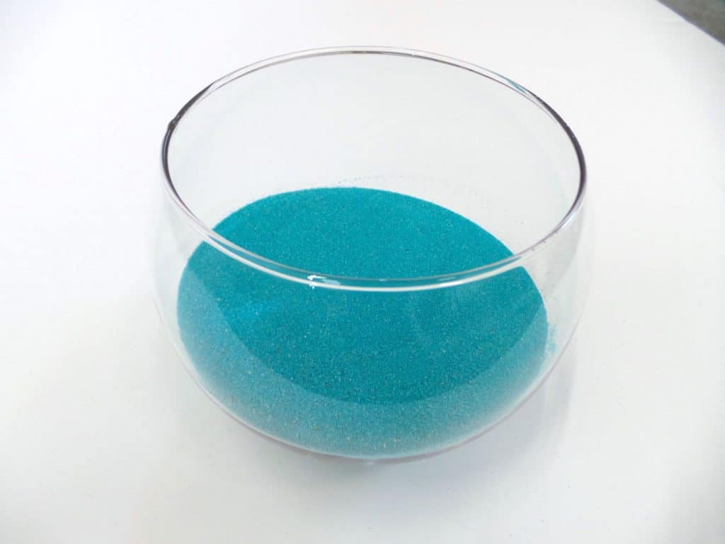 Craft sand in a clear glass bubble bowl
