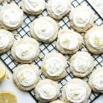 Lemon cookies with cream cheese icing on a wire rack