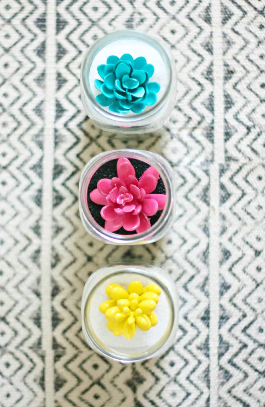 These sand art terrariums are a perfect pairing of a craft you loved as a kid combined with trendy succulents! It's really easy to do with any colors.