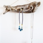 Use a gorgeous driftwood piece to create a unique jewelry hanger. It looks great on the wall whether you have jewelry on it or not, and it's easy to make!
