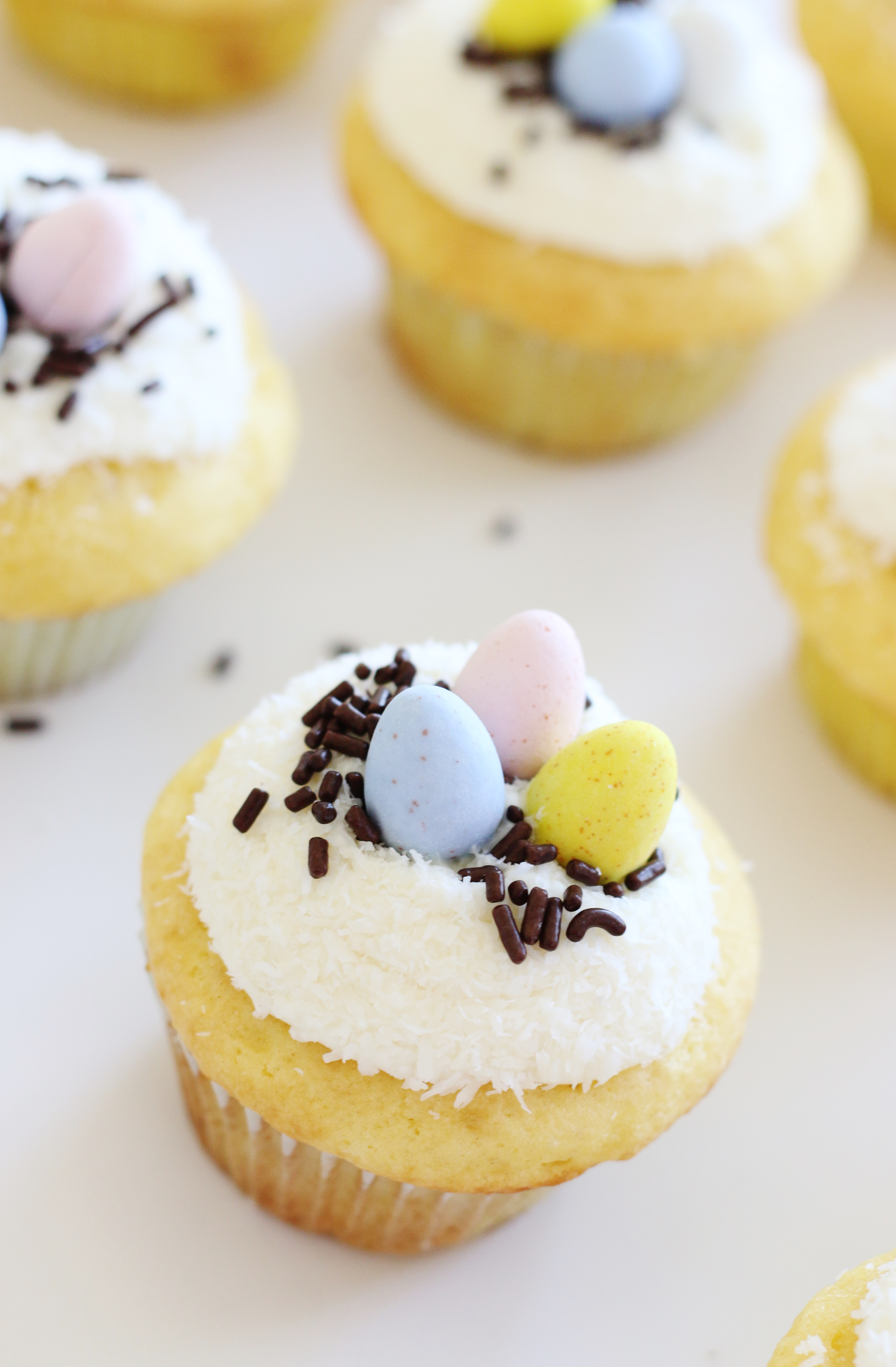 Make delicious Easter cupcakes using a secret ingredient - cake mix! Then add cute Cadbury eggs on top for a fun bird's nest effect that is so festive!