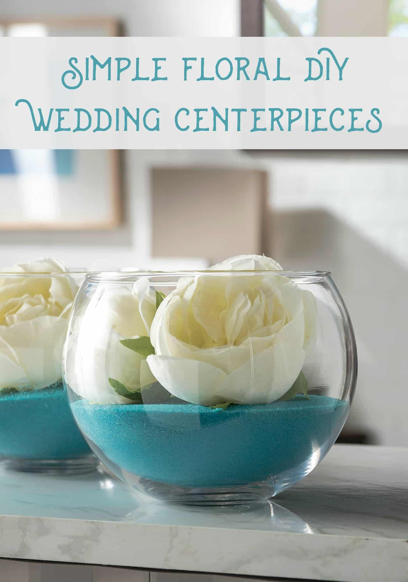 DIY wedding centerpieces using sand and faux flowers